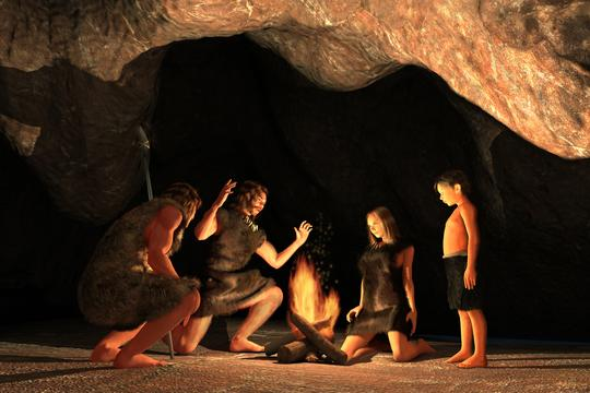 Neandertalci okupljeni oko vatre u špilji