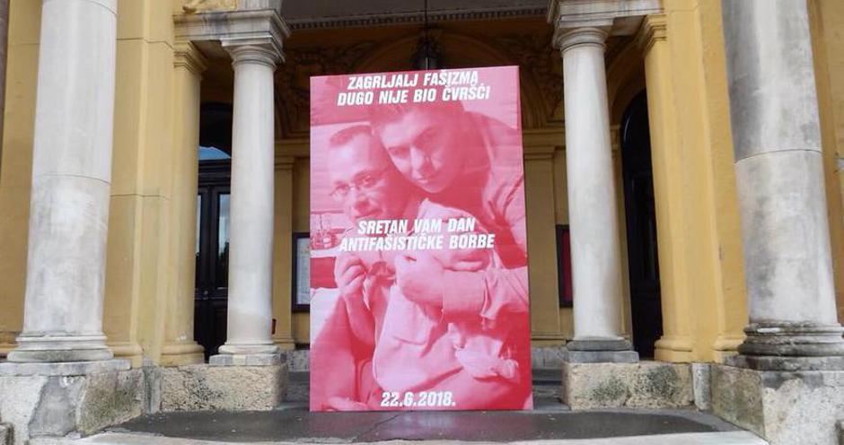 Plakat sa Zlatkom Hasanbegovićem i Velimirom Bujancem ispred HNK, 22. lipnja 2018. | Author: Oliver Frljić